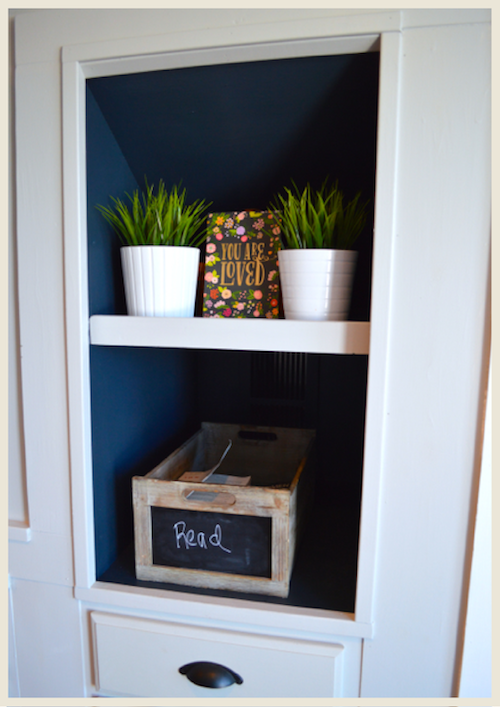 Moody built-in shelves painted with dark blue color by NewlyWoodwards.