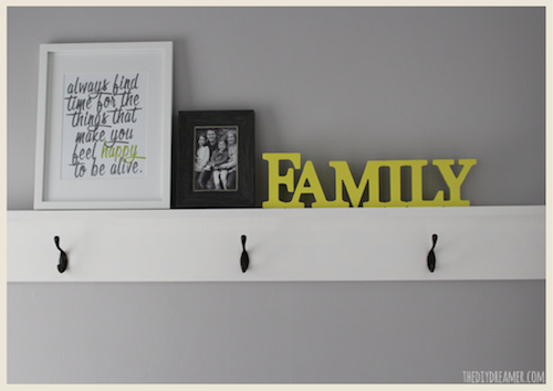 A small entryway makeover and decorative shelf with hooks by The DIY Dreamer.