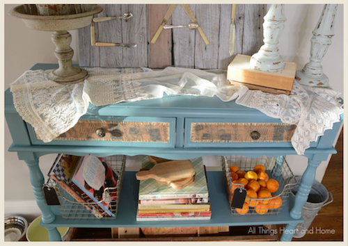 A console table painted in blue clay by All Things Heart and Home