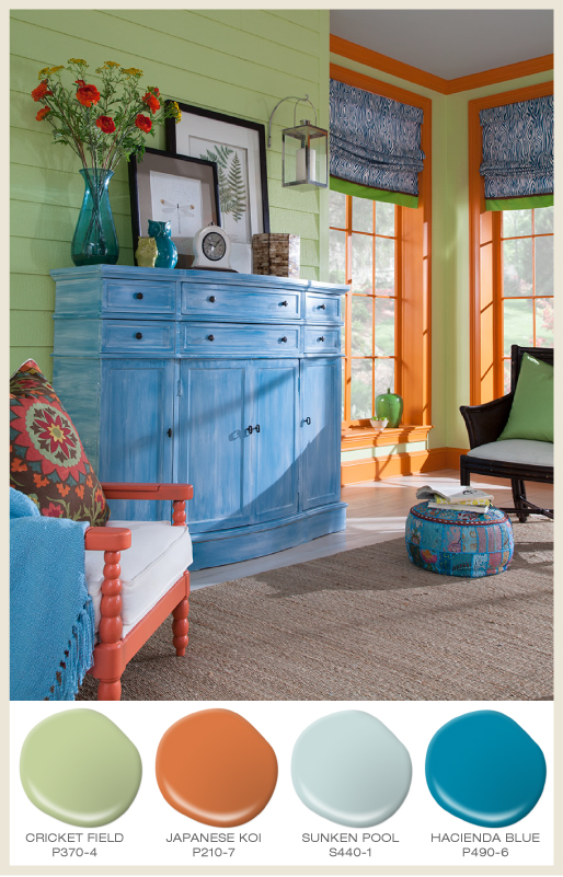 A green paneled sun-room with bright orange window trim and blue accents.