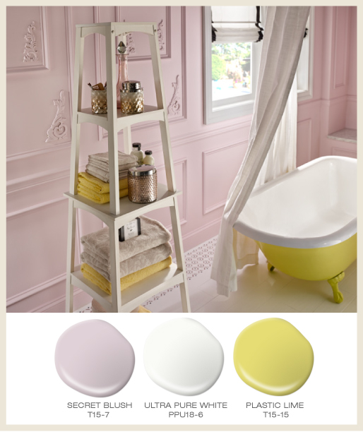 A classic pink bathroom with claw-foot tub painted in bright limy color.