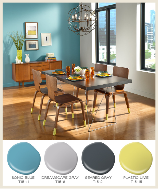 An urban dining room, decorated with modern furniture.  Dining chair legs are painted in a bright limy color called Plastic Lime.