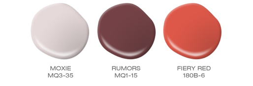 A group of paint spills featuring the following a light pink, a burnt red and a fiery red. BEHR colors included: Moxie, Rumors, Fiery Red.