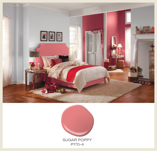 A girl's bedroom featuring light gray walls, white trim and coral accents.