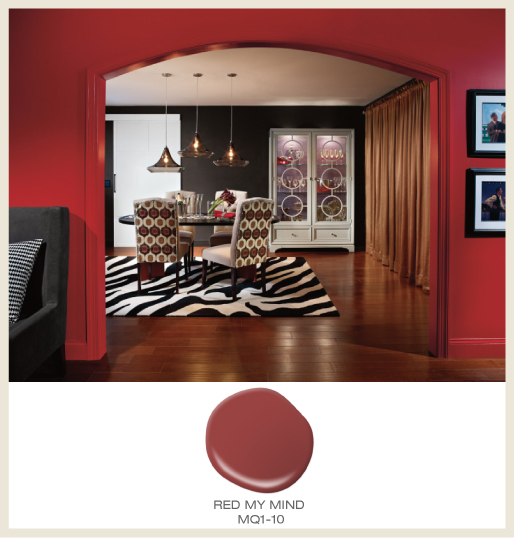 A dramatic dining room and hallway featuring black and red walls.