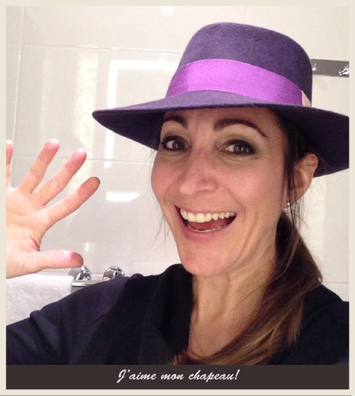 Erika's selfie with a custom Parisian hat.