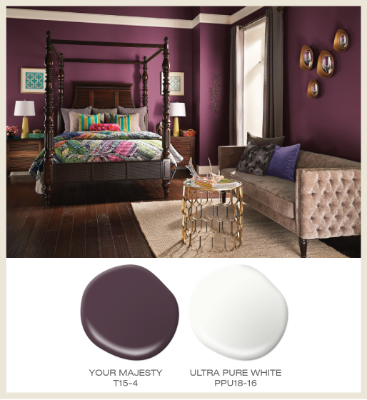 A global style bedroom featuring deep magenta walls and white trim.
