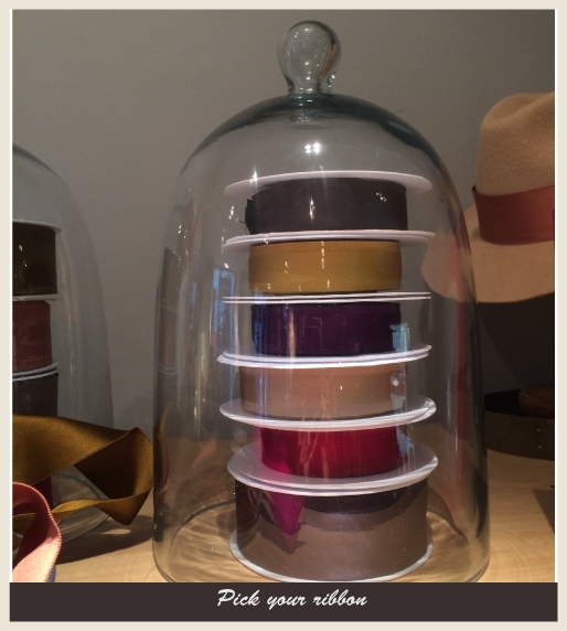A glass container featuring different color ribbons.