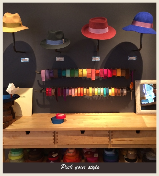 A frame showing different hats and ribbon colors.