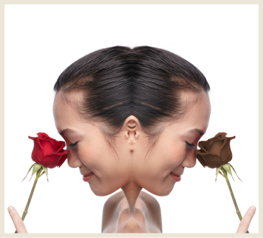 A frame showing a woman's profile facing opposite directions and holding a red rose and brown rose.