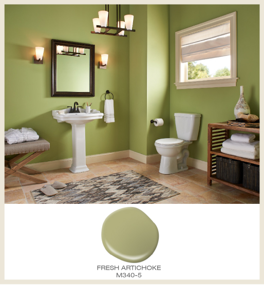A spacious classic  bathroom with all walls painted in green.