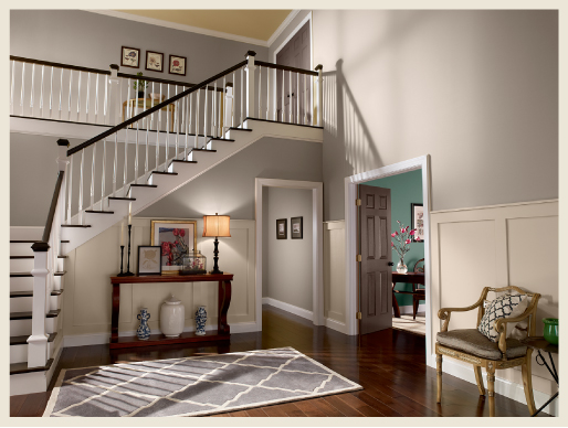 Large home interior showcasing a staircase, foyer, hallway and an office.