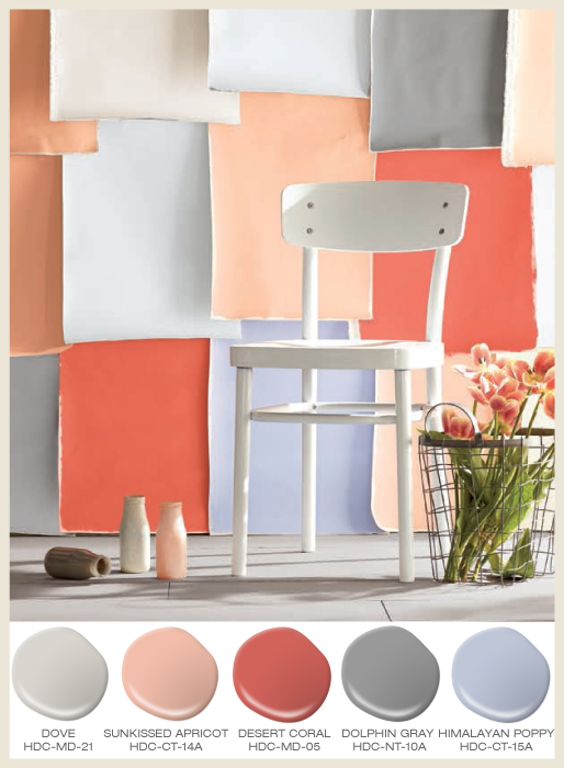 A wall covered with layers of colorful construction paper sheet, creating a beautiful and original design.