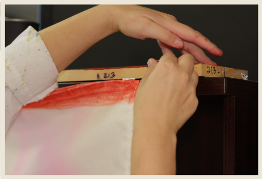 A woman's hands rehanging pillow case for drying dye mark.