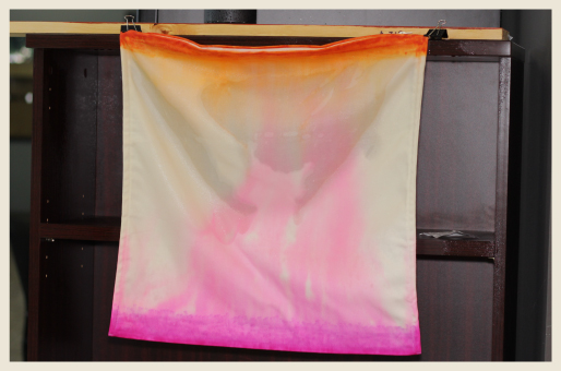 A pillow case with two-tone dye beginning to disperse and creating an ombre look.