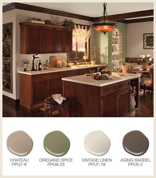 A neutral Mediterranean style kitchen with a corner built-in painted in sage green color.
