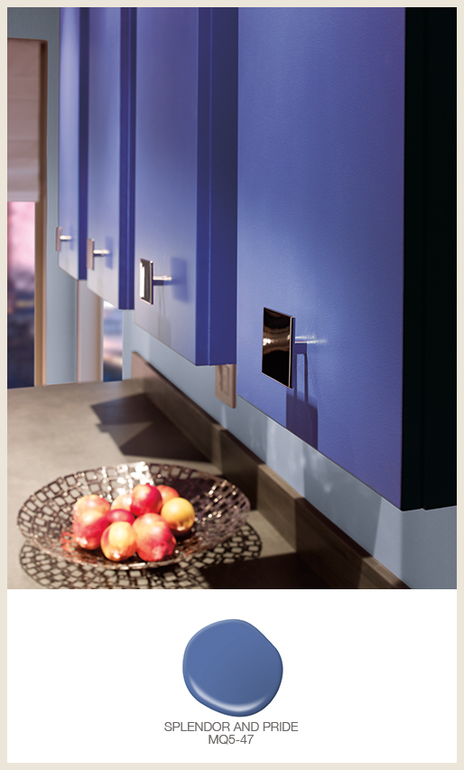 A modern kitchen cabinets painted in an electric blue color.