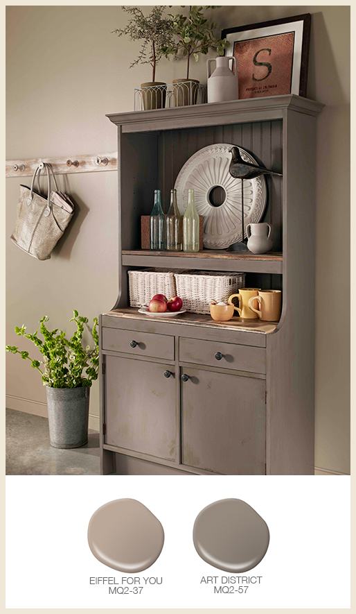 A tone on tone kitchen wall with a gray hutch.