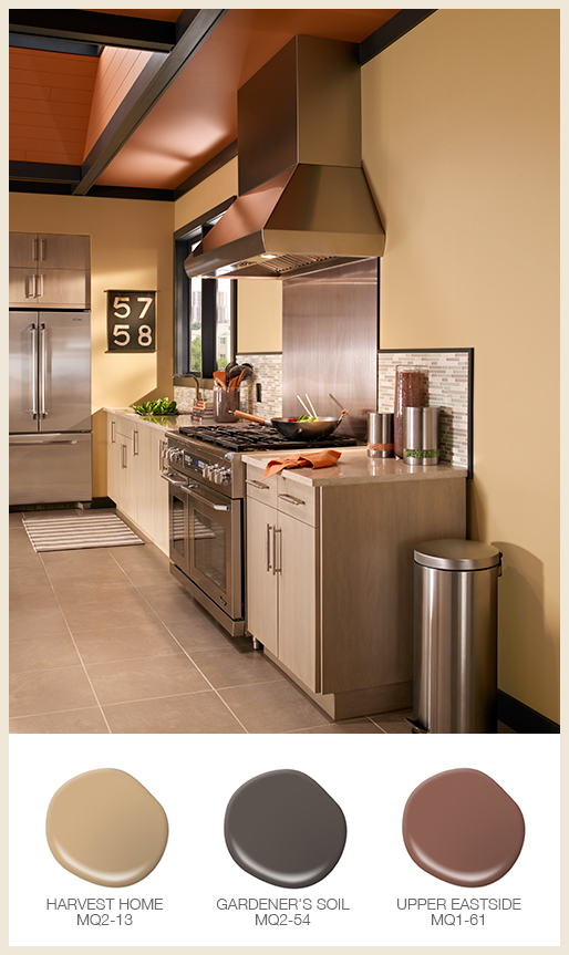 A vertical shot of a residential kitchen with yellow walls and orange ceiling.