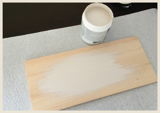 A wood board being painted.