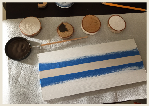 Multiple birch rings being painted.