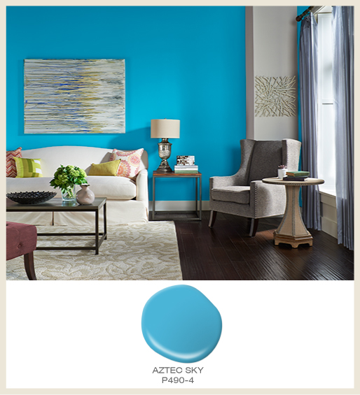 A contemporary living room with bright blue wall. Featured wall color is Aztec Blue.