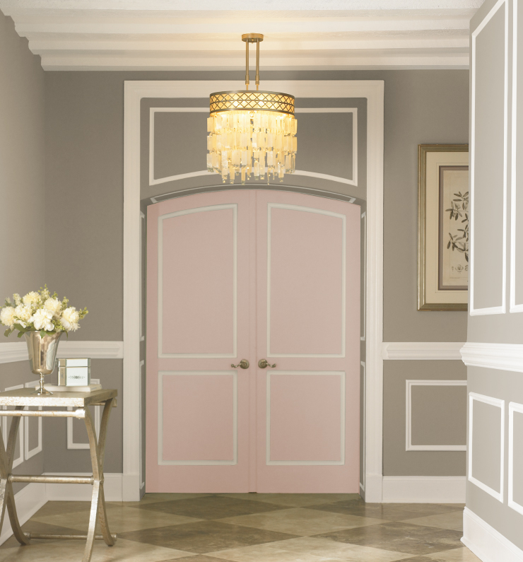 A interior entryway painted in gray and white with the doors painted in Cupcake Pink