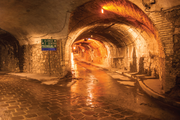 Underground tunnels, road signs direct traffic through subterranean roadways created from ancient silver mines run beneath downtown Guanajuato.