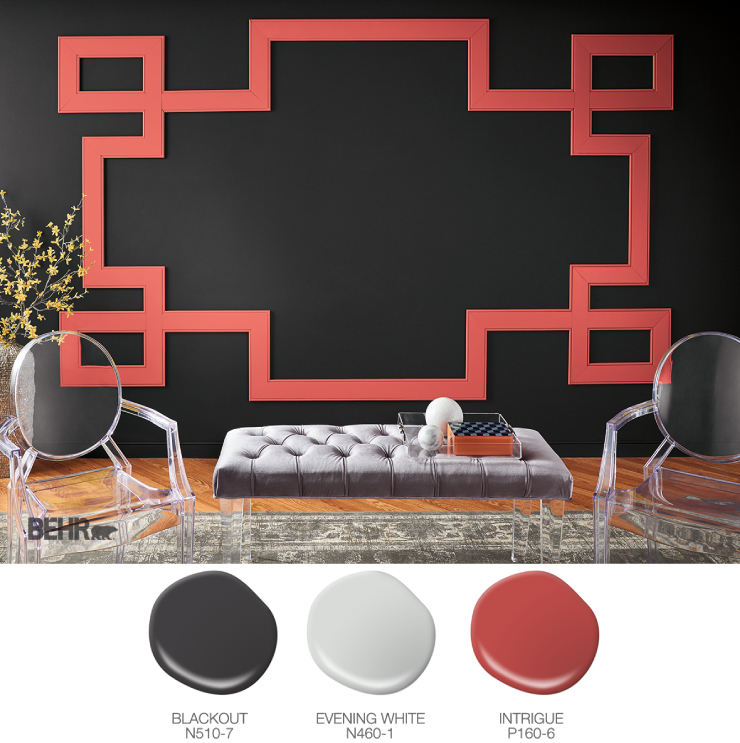 A sitting area painted in black with red trim.  Paint drops in black, gray and red.