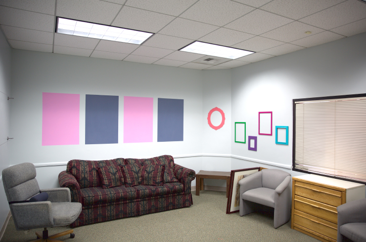 An after photo of painted and decorated wall.