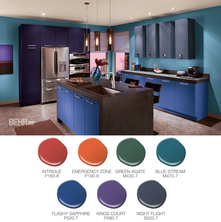 A kitchen painted in jewel-toned colors. Paint drops in red, orange, green, blues, purple and grays.