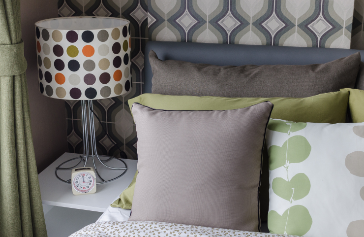 lamp shade in polka-dots and pillows solid and with vine leaves.