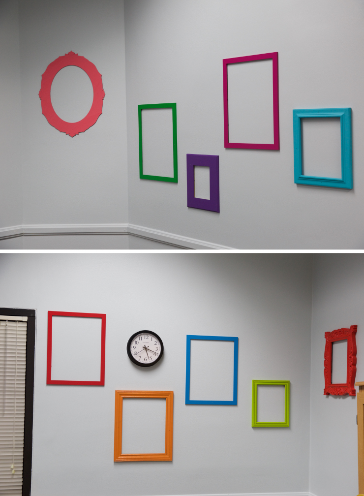 A wall decorated with multiple bright painted picture frames.