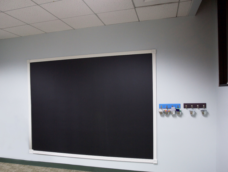 An after shot of wall mounted chalk board.
