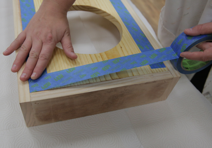 Adding painters tape on the inside varnished edge.