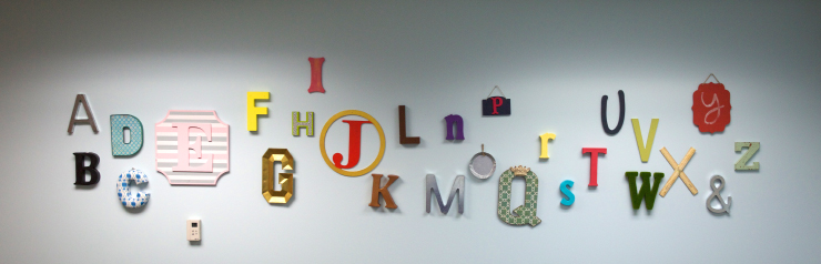 An after shoot of alphabet mounted on the wall.