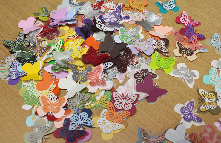 A collection of paper cut butterflies ready to mount on the wall.