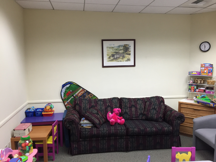 A before image of a messy playroom