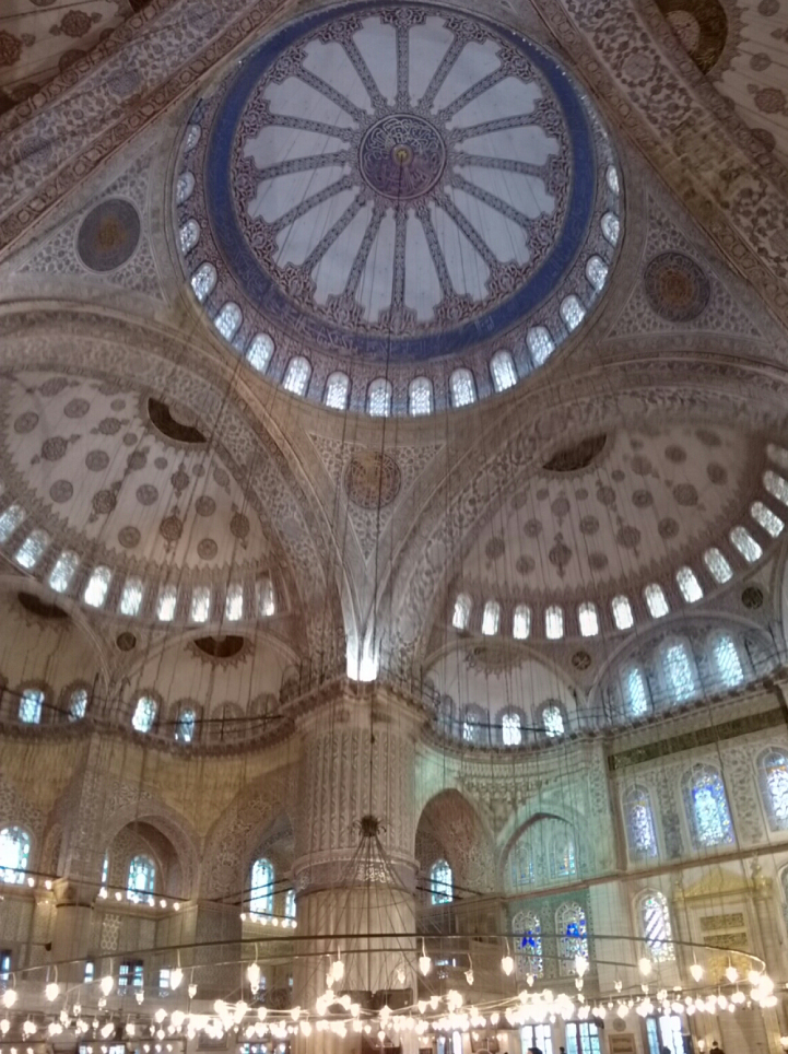 Interior of the Blue Mosque with it;s beautiful detailed ceilings.