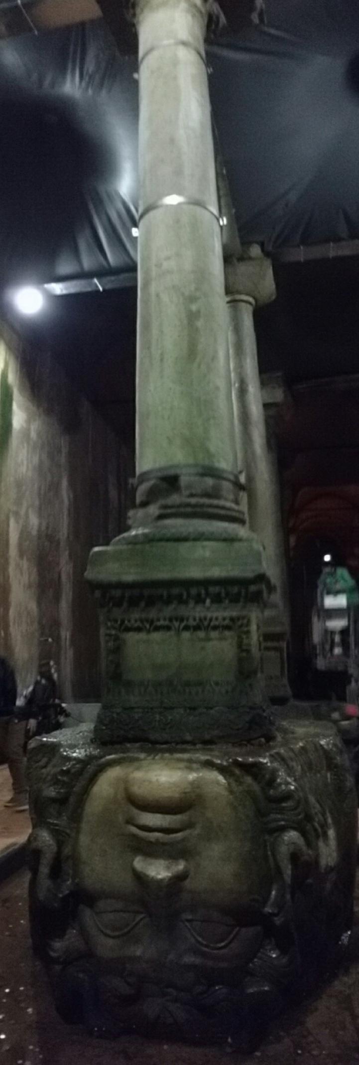 Medusa head at the base of the Basilica Cistern column.