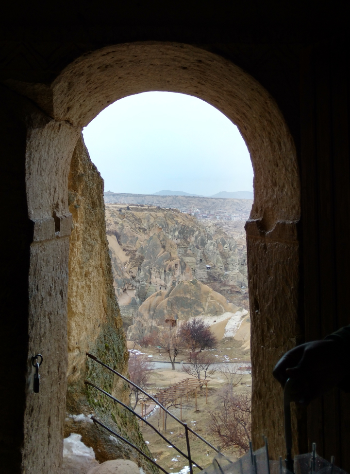 A tight ancient cave church view from an arch doorway.