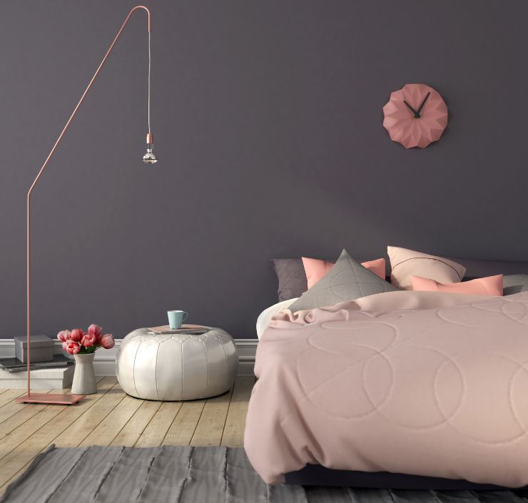 A bedroom painted in a gray color with accents in pink.