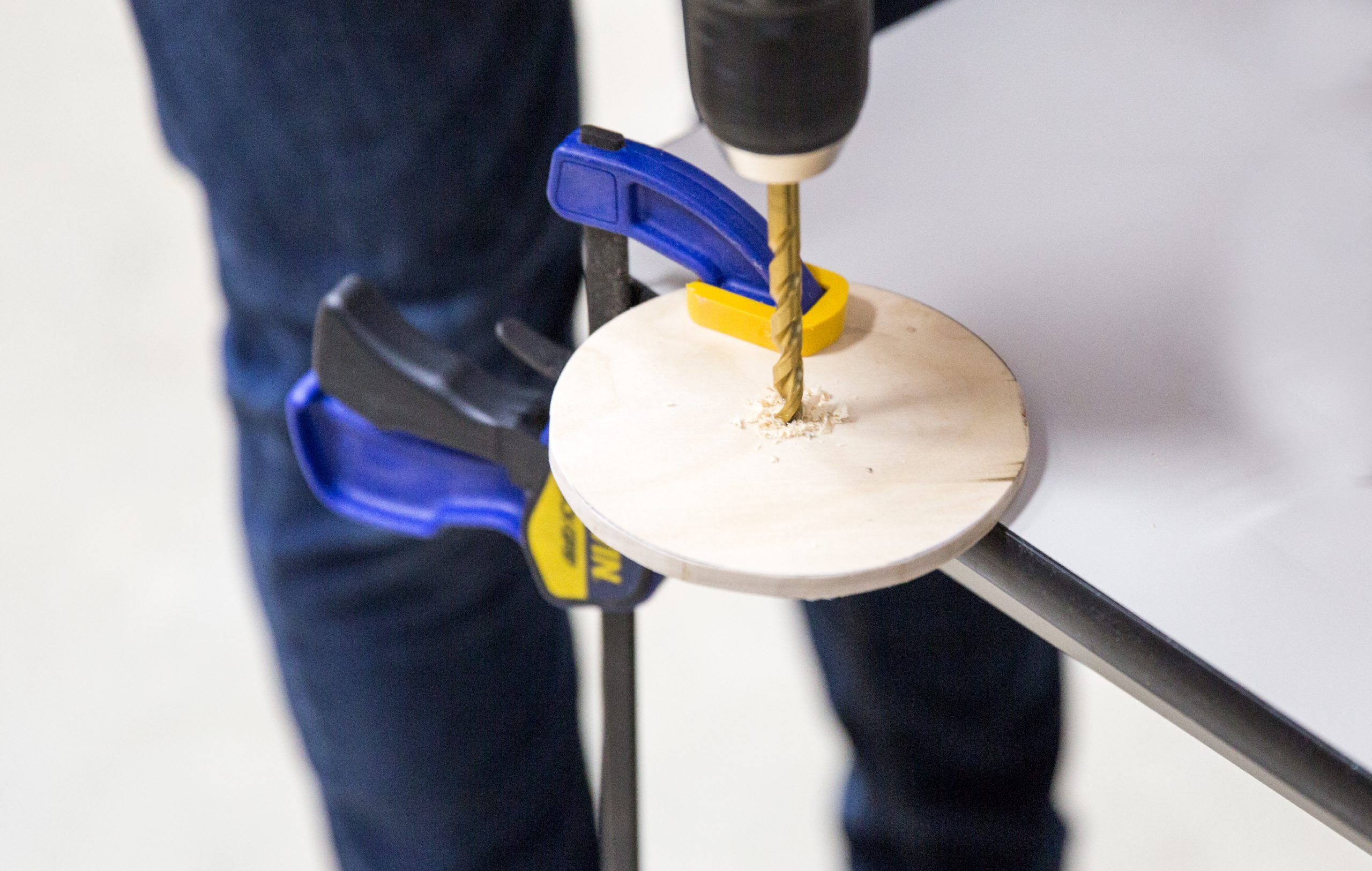 Drilling a hole in the center of the circle.