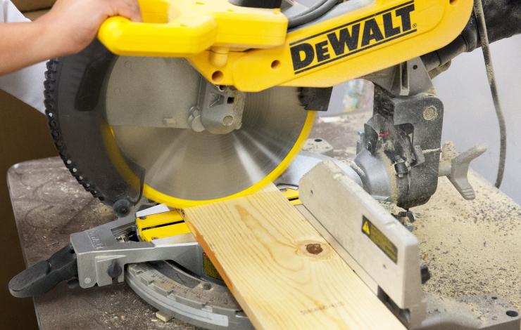Cutting a wood board.