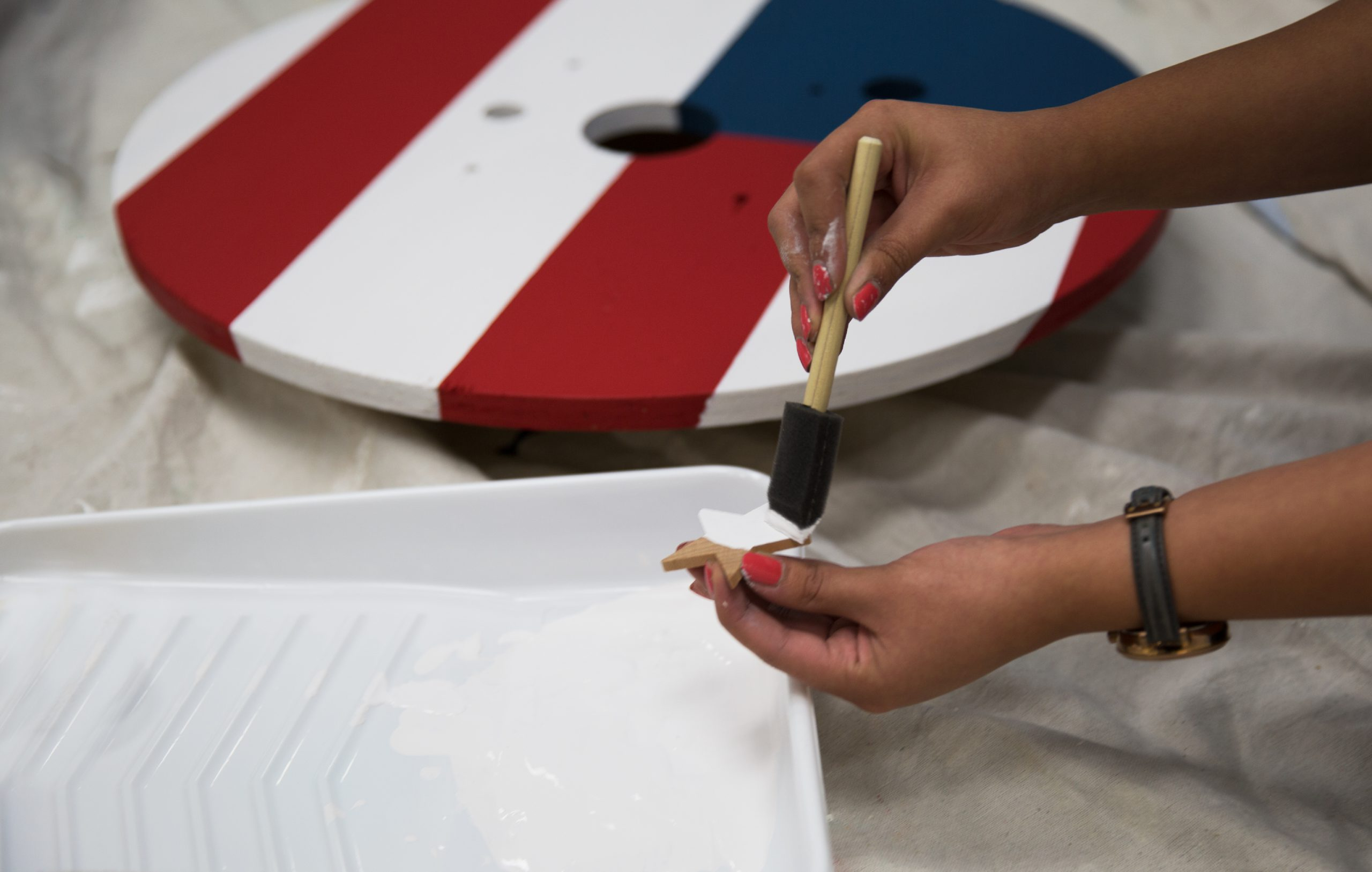 Painting stars onto a stamp stencil.