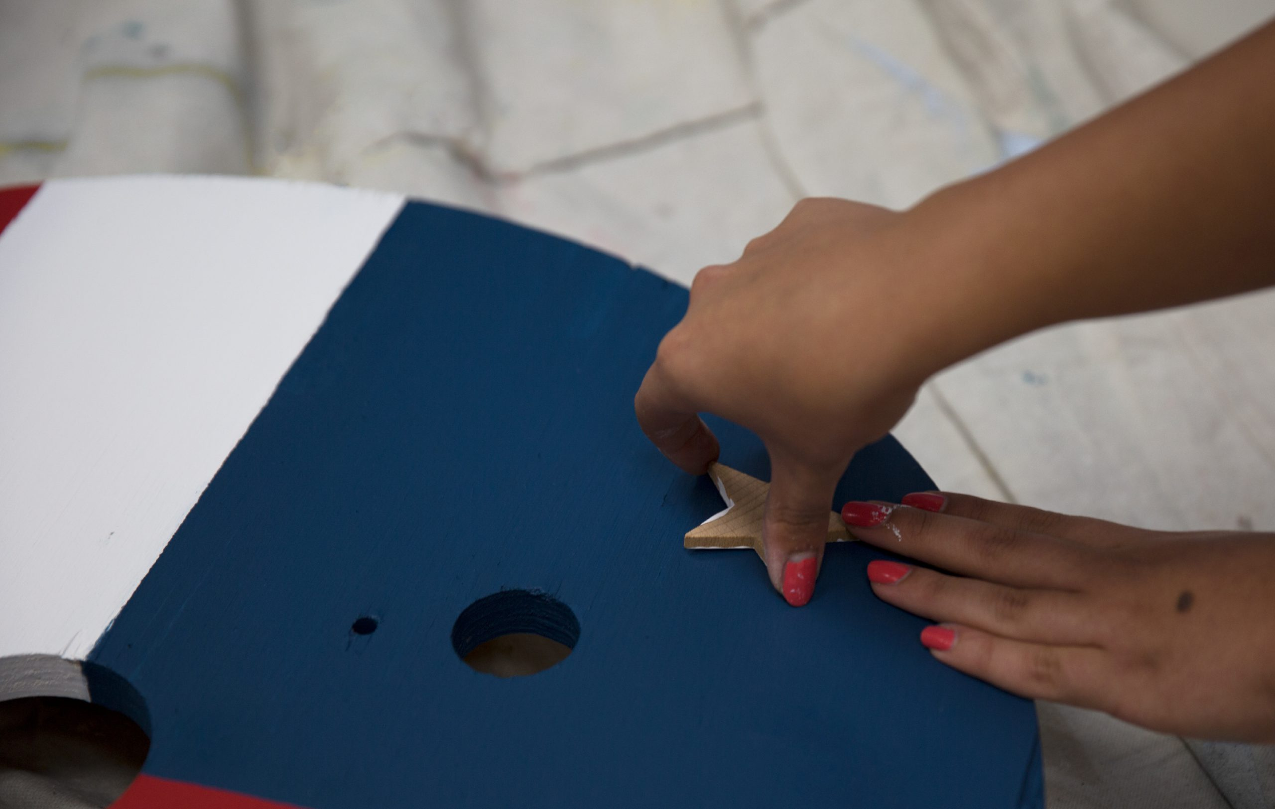 Stamping the painted star stamp on to flag design.