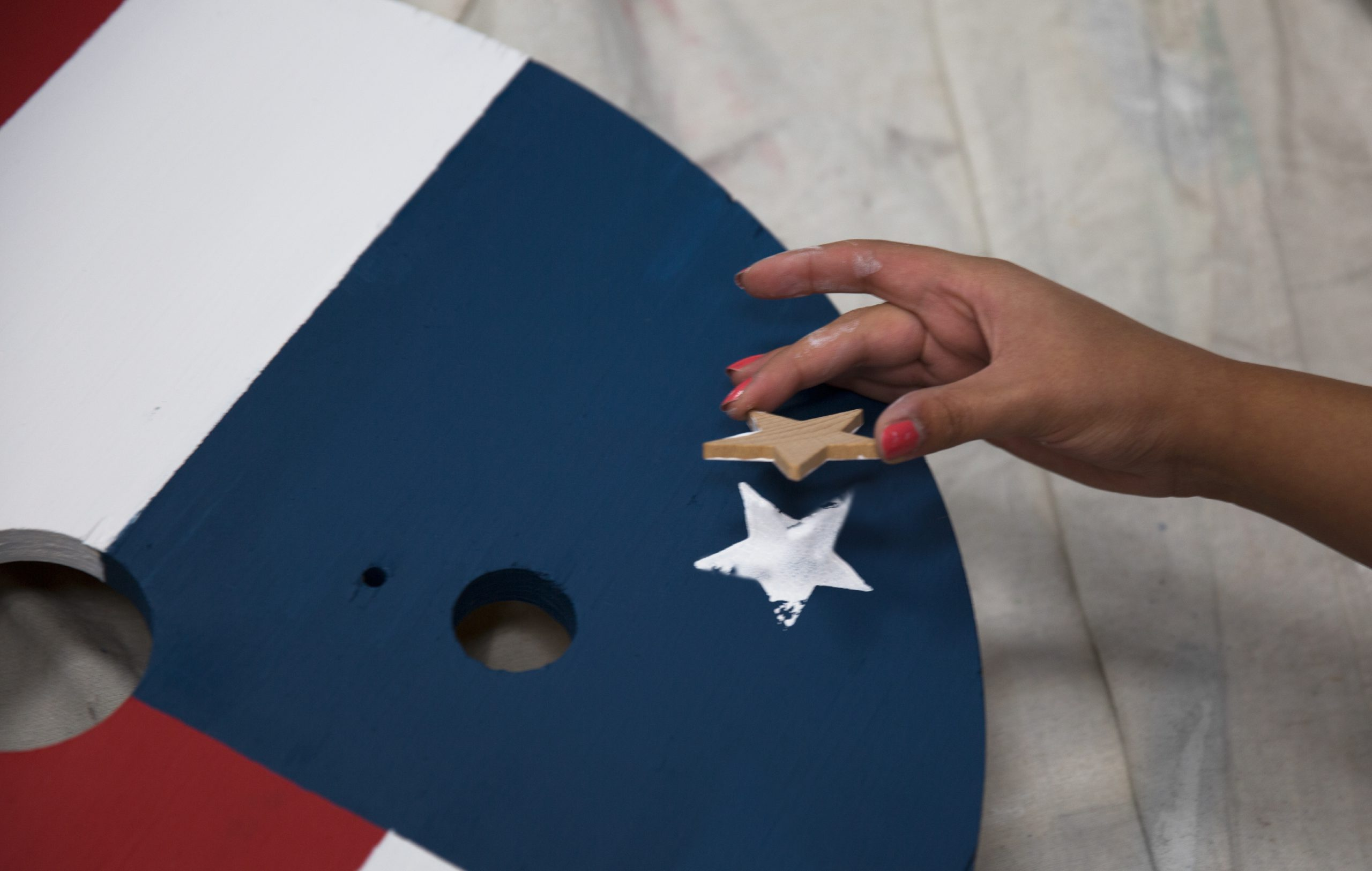 Showing the painted star left behind from the stamp stencil on to the flag design.