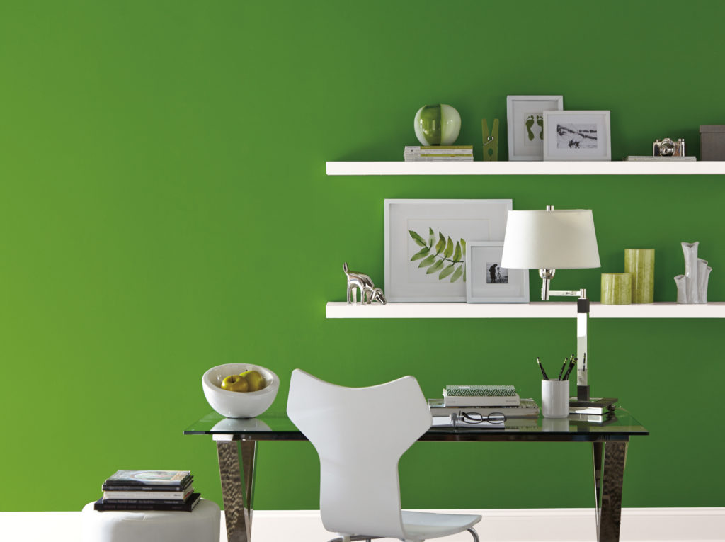 Office with walls painted in a bright green color.