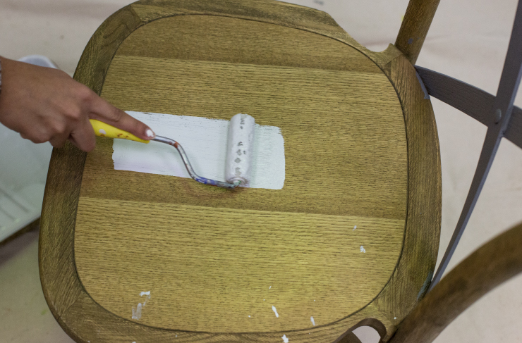 painting the chair with white paint.