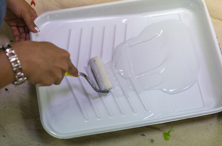 White paint in a paint tray.